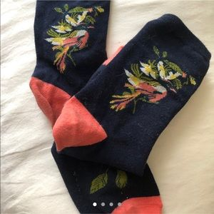 Navy ankle socks with floral design.